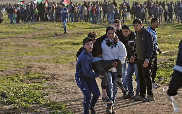 Palestinian teens killed by Israeli fire in border clashes - Gaza Health Ministry