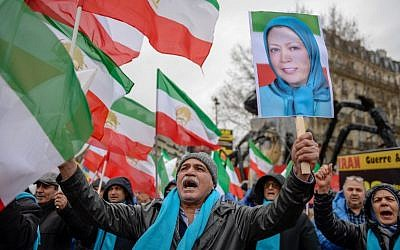 People wave former Iranian flags and a picture of Maryam Rajavi, leader of the People's Mujahedin of Iran, during a demonstration of the exiled Iranian opposition to protest against the Iranian government on February 8, 2019 in Paris. (AFP)