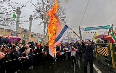 Iranians burn Israeli flags during commemorations in the capital Tehran of the 40th anniversary of the Islamic on February 11, 2019. (Atta Kenare/AFP)