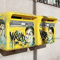 Anti-Semitic graffiti written on letter boxes displaying a portrait of late French politician and Holocaust survivor Simone Veil, in the 13th arrondissement of Paris, February 11, 2019. (Jacques Demarthon/AFP)
