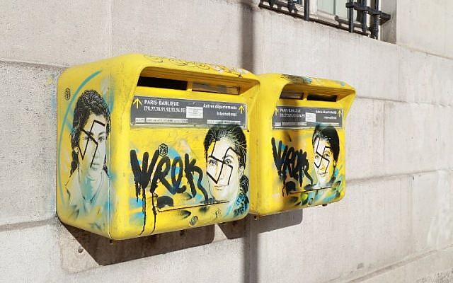 Antisemitic graffiti seen on letter boxes displaying a portrait of late French politician and Holocaust survivor Simone Veil, in the 13th arrondissement of Paris, February 11, 2019. (Jacques Demarthon/AFP)