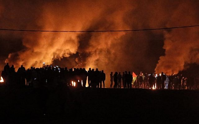 Palestinian rioters take part in a night demonstration near the fence along the border with Israel, east of Gaza City, on February 11, 2019. (MAHMUD HAMS / AFP)