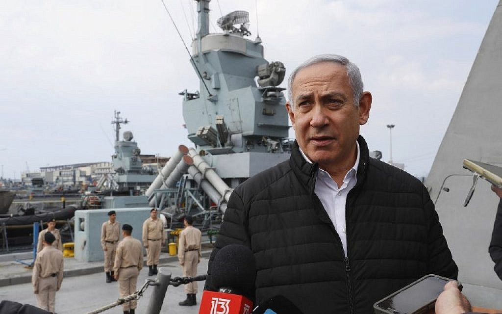 Prime Minister Benjamin Netanyahu speaks to journalists during a visit to inspect a naval Iron Dome defense system in the northern port of Haifa on February 12, 2019. (JACK GUEZ / POOL / AFP)