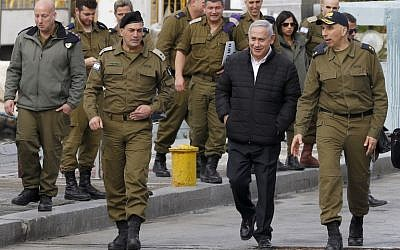 Prime Minister Benjamin Netanyahu during a visit to a base in Haifa, on February 12, 2019. (JACK GUEZ / POOL / AFP)