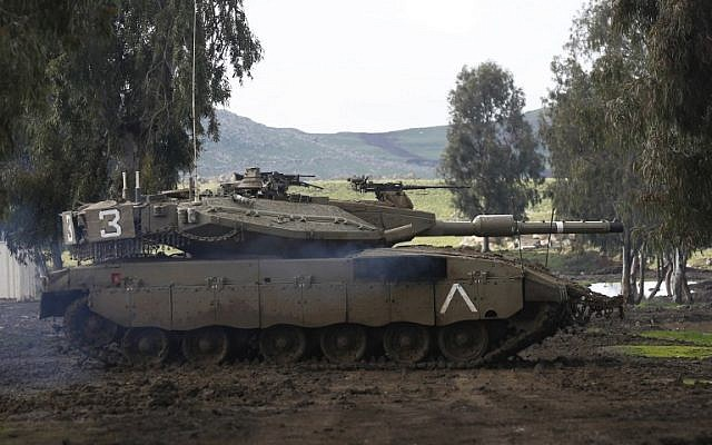 An Israeli army Merkava tank takes part in a military drill in the Israeli-annexed Golan Heights on February 12, 2019. (Photo by JALAA MAREY / AFP)