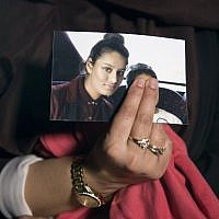 In this file photo taken on February 22, 2015, Renu Begum, eldest sister of British Islamic State member Shamima Begum, holds a picture of her sister while being interviewed by the media in central London. (Laura Lean/Pool/AFP)