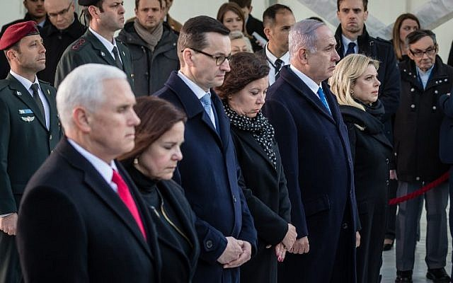 US Vice President Mike Pence, his wife Karen, Poland's Prime Minister Mateusz Morawiecki, his wife Iwona and Israeli Prime Minister Benjamin Netanyahu with his wife Sara are pictured during a wreath laying ceremony at the Ghetto Heroes Monument in Warsaw, Poland, on February 14, 2019. (Wojtek Radwanski / AFP)