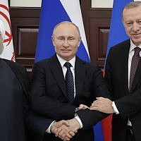 Russian President Vladimir Putin (C), Turkish President Recep Tayyip Erdogan (R) and Iranian President Hassan Rouhani pose prior to a trilateral meeting on Syria in the Black Sea resort of Sochi on February 14, 2019. (Sergei Chirikov/Pool/AFP)