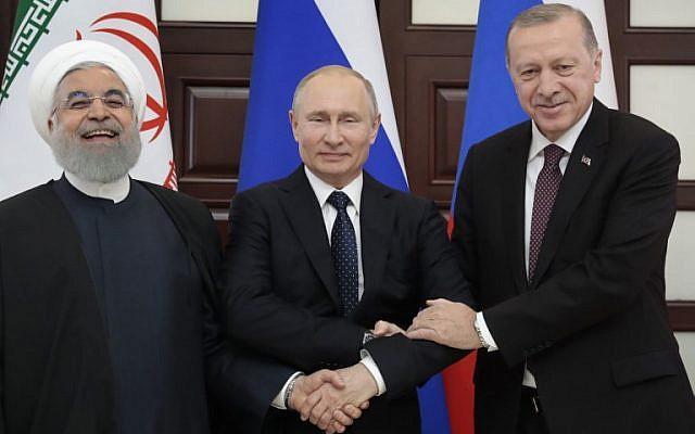 Russian President Vladimir Putin (C), Turkish President Recep Tayyip Erdogan (R) and Iranian President Hassan Rouhani pose prior to a trilateral meeting on Syria in the Black Sea resort of Sochi on February 14, 2019. (Sergei Chirikov/Pool/AFP)