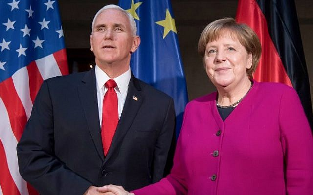 German Chancellor Angela Merkel (R) and US Vice President Mike Pence shake hands at a photo call during the 55th Munich Security Conference on February 16, 2019. (Sven Hoppe / dpa / AFP)