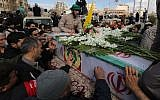 Iranian mourners gather around the coffins of Revolutionary Guards who were killed in a suicide attack, during their funeral in southeastern city of Isfahan on February 16, 2019. (ATTA KENARE/AFP)