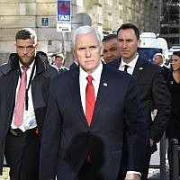 US Vice President Mike Pence (C) crosses a street to give a statement in front of the Bayerischer Hof hotel at the 55th Munich Security Conference in Munich, southern Germany, on February 16, 2019. (THOMAS KIENZLE / AFP)