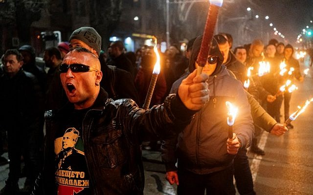 Members of nationalist organizations parade with torches during a march to commemorate Bulgarian General and politician Hristo Lukov, in the centre of Sofia on February 16, 2019. (Dimitar DILKOFF / AFP)