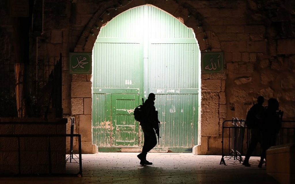 An Israeli border police officer patrols an entrance to the Temple Mount in Jerusalem's Old City, on February 19, 2019.  (Ahmad Gharabli/AFP)