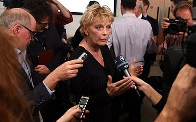 Pro-Europe British politician, Conservative party MP Anna Soubry, center, speaks to members of the media at a People's Vote campaign press conference in London on December 11, 2018. (Oli SCARFF/AFP)