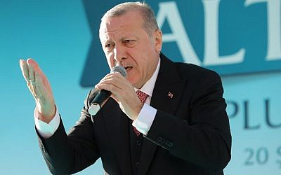 Turkish President and the leader of Turkey's ruling Justice and Development Party (AKP) Recep Tayyip Erdogan delivers a speech during his party's campaign rally in Altindag district of Ankara, Turkey on February 20, 2019. (Photo by Adem ALTAN / AFP)