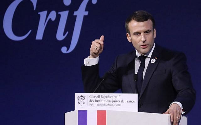 French President Emmanuel Macron speaks during the 34th annual dinner of the Representative Council of Jewish Institutions of France (CRIF - Conseil Representatif des Institutions juives de France) on February 20, 2019, at the Louvre Carrousel in Paris.  LUDOVIC MARIN / POOL / AFP)
