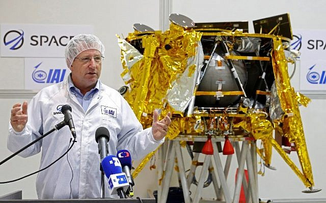 In this file photo taken on December 17, 2018, Israel Aerospace Industries space division director Opher Doron stands in front of the Beresheet spacecraft during a presentation by Israeli nonprofit SpaceIL and Israeli state-owned IAI, in Yehud, east of Tel Aviv. (Jack Guez/AFP)