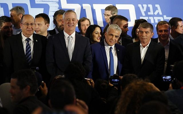From left to right: Blue and White party leaders Moshe Ya'alon, Benny Gantz , Yair Lapid and Gabi Ashkenazi pose for a picture after announcing their new electoral alliance in Tel Aviv on February 21, 2019. (Jack Guez/AFP)
