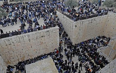 Palestinians worshipers gather before Friday noon prayers at the premises of the Golden Gate on the Temple Mount in the Old City of Jerusalem, on February 22, 2019. (Ahmad Gharabli/AFP)