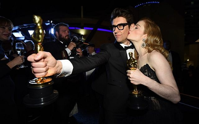Best Live Action Short Film winners for 'Skin' director Guy Nattiv, left,  and Jaime Ray Newman attend the 91st Annual Academy Awards Governors Ball at the Hollywood and Highland Center in Hollywood, California on February 24, 2019. (Robyn BECK/AFP)