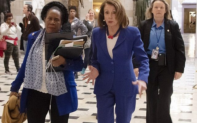US Speaker of the House Nancy Pelosi (C R)) and congresswoman Sheila Jackson Lee (C L) walk to the House Chambers, to vote on blocking the national emergency over border situation on Capitol Hill in Washington, DC, on February 26, 2019. (Photo by Jim WATSON / AFP)
