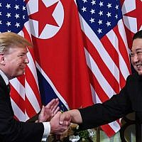 US President Donald Trump, left, shakes hands with North Korea's leader Kim Jong Un following a meeting at the Sofitel Legend Metropole hotel in Hanoi on February 27, 2019. (Saul LOEB/AFP)