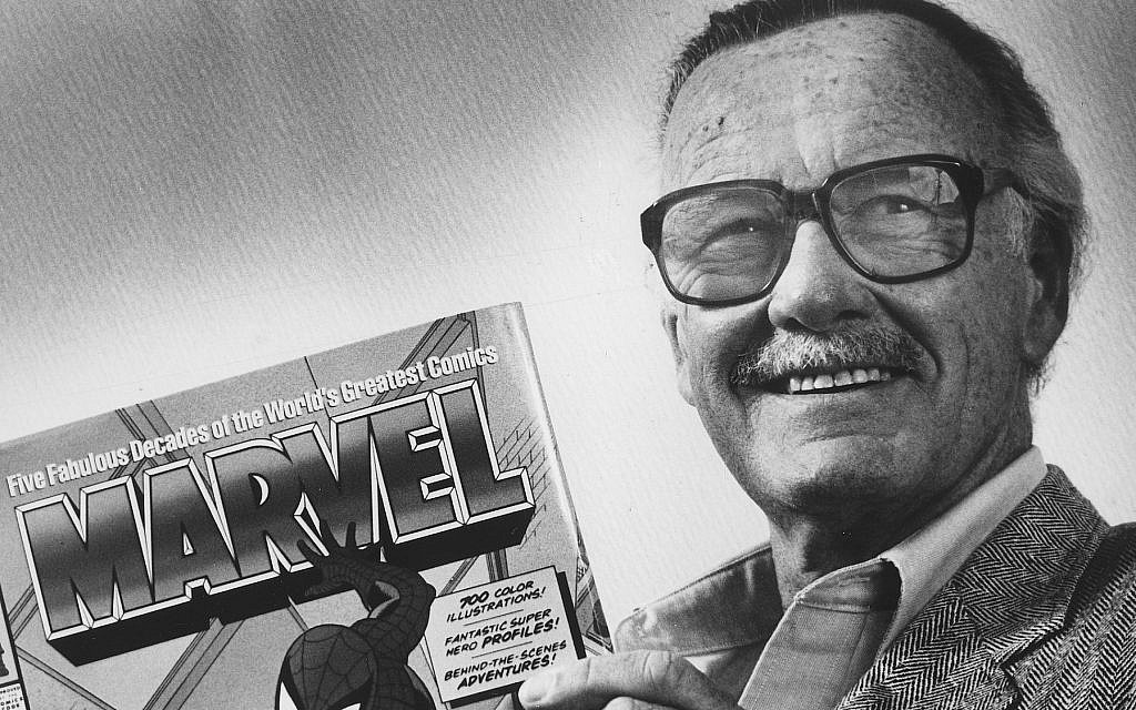 "Stan Lee poses with a book of ""Spider Man"" comics in 1991. Along with Spider Man, Lee created characters such as Iron Man, Thor and The Incredible Hulk. (Gerald Martineau/The Washington Post via Getty Images via JTA)"