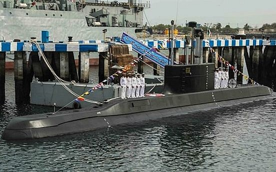 Iran launches cruise missile from submarine during drill