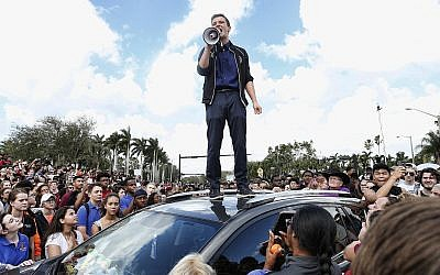 Marjory Stoneman High School student Cameron Kasky addresses area students at a rally at the school after participating in a countywide school walkout in Parkland, Florida, February 21, 2018. (Rhona Wise/AFP/Getty Images/via JTA)