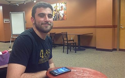 Josh Boloña, pictured sitting in his campus library, is the president of the Student Government Association at the University of Central Florida. (Ben Sales)