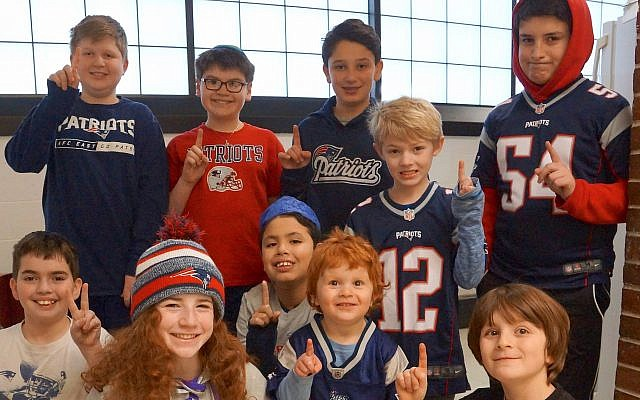 Students at the MetroWest Jewish Day School in Framingham, Mass., show off gear for their favorite team on Patriots Ruach (Spirit) Day, Feb. 1, 2019. (Courtesy of MetroWest Jewish Day School)