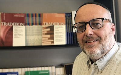 Rabbi Jeffrey Saks, the newly named editor of Tradition magazine, in his Jerusalem office. (Sam Sokol)