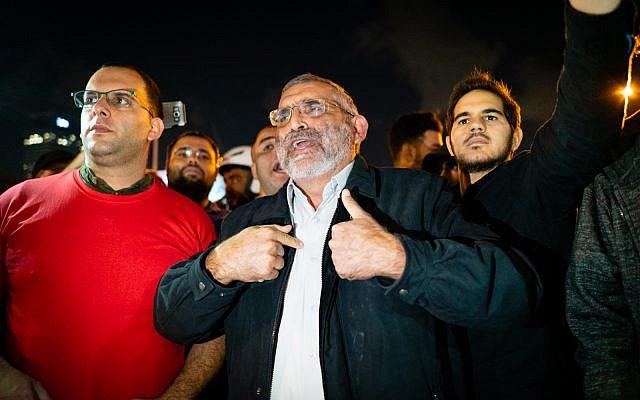 Michael Ben Ari, head of far-right Otzma Yehudit, and supporters at a Tel Aviv demonstration, November 15, 2018. (Luke Tress/Times of Israel)