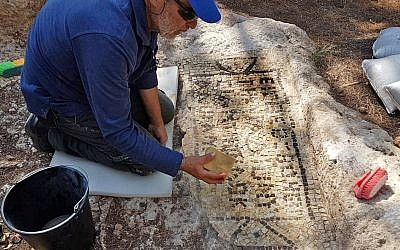 Preservation work on the 1,600-year-old inscription and wine press unearthed at the home of a wealthy Samaritan in Tzur Natan. (Galeb Abu Diab/Israel Antiquities Authority)