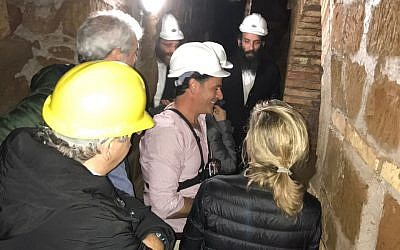 A group visiting the Villa Torlonia Jewish Catacombs guided by Amir Genach, center. (courtesy Amir Genach)