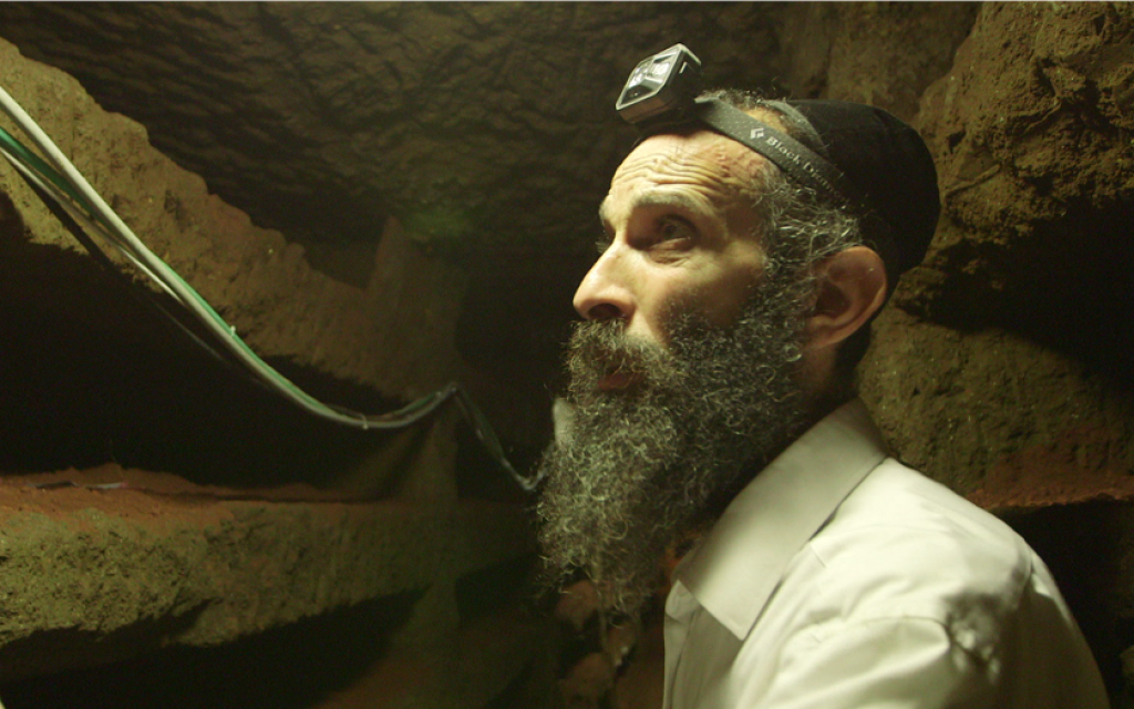 Rabbi Chizkiya Kalmanovich from the European Committee for the .Protection of Jewish Cemeteries in the Villa Torlonia catacombs (courtesy Amir Genach)