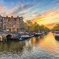 Sunset over a canal in Amsterdam (AP)