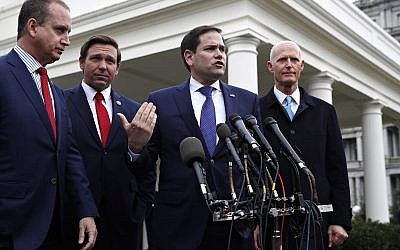 In this January 22, 2019, photo, Representative Mario Diaz-Balart, left, Florida Governor Ron DeSantis, Senator Marco Rubio and Senator Rick Scott, speak to the media after their meeting with US President Donald Trump about Venezuela, at the White House in Washington. (AP Photo/Jacquelyn Martin)