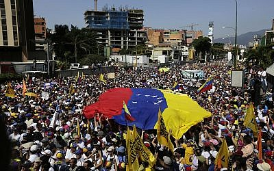 Anti-government protesters gather for the start of a nationwide demonstration demanding the resignation of President Nicolas Maduro, in Caracas, Venezuela,  Feb. 2, 2019  (AP Photo/Fernando Llano)