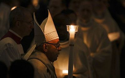 Pope Francis holds a candle as he arrives to celebrate Mass with members of religious institutions on the occasion of the celebration of the XXIII world day of consecrated life in St. Peter's Basilica, at the Vatican, February 2, 2019. (AP Photo/Gregorio Borgia)