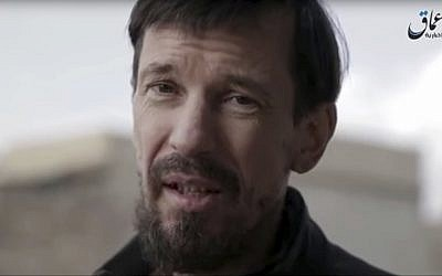 Image from video released December 7, 2016 by the Islamic State's Amaq news agency, shows captive British photojournalist John Cantlie in what appeared to be central Mosul, Iraq. (Islamic State's Amaq News Agency via AP)