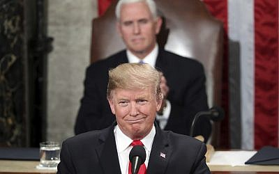 US President Donald Trump delivers his State of the Union address to a joint session of Congress on Capitol Hill in Washington, as Vice President Mike Pence watched, February 5, 2019. (AP Photo/Andrew Harnik)