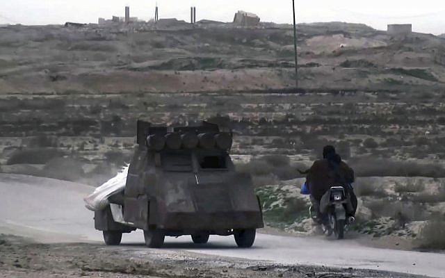 This frame grab from video posted online January 18, 2019, by supporters of the Islamic State group, purports to show an IS fighter driving a car bomb during clashes with members of the US-backed Syrian Democratic Forces, in the eastern Syrian province of Deir el-Zour, Syria. (Militant Photo via AP)