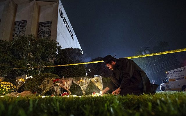 In this October 27, 2018 photo, Rabbi Eli Wilansky lights a candle after a mass shooting at the Tree of Life Synagogue in Pittsburgh's Squirrel Hill neighborhood. (Steph Chamber/Pittsburgh Post-Gazette via AP, File)