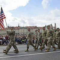 In this August 15, 2018, photo, a group of US Army soldiers take part in an annual military parade celebrating Polish Army Day in Warsaw, Poland. (AP Photo/Alik Keplicz, File)