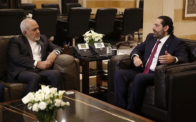 Lebanese Prime Minister Saad Hariri, (R), meets with Iran's Foreign Minister Mohammad Javad Zarif, at the government palace, in Beirut, Lebanon, Monday, Feb. 11, 2019. (AP Photo/Hussein Malla)