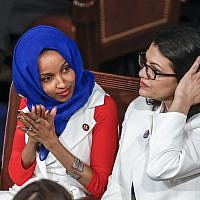 In this photo from February 5, 2019, US Rep. Ilhan Omar, a Minnesota Democrat, left, is joined by Rep. Rashida Tlaib, a Michigan Democrat, at US President Donald Trump's State of the Union speech, at the Capitol in Washington. (AP Photo/J. Scott Applewhite)