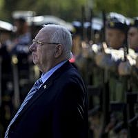 President Reuven Rivlin reviews a military guard of honor during a welcoming ceremony before a meeting with Cyprus's President Nicos Anastasiades at the presidential palace in Nicosia, Cyprus, on February 12, 2019. (AP Photo/Petros Karadjias)