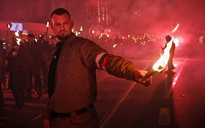 "A man holds a flare as people take part in the ""Lukov March,"" staged by the far-right Bulgarian National Union, in Sofia, Bulgaria, Saturday, Feb. 16, 2019. (AP/Vadim Ghirda)"